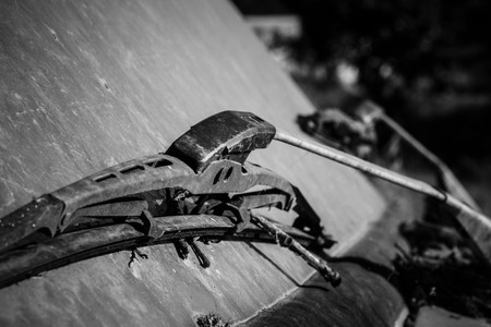 windshield: old damaged windscreen wipers in black white Stock Photo