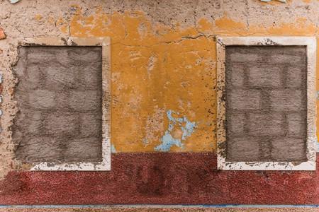 run down: cemented windows of a run down house Stock Photo