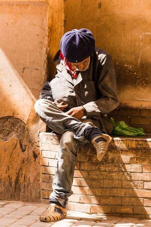 poor man: marrakesh, Morocco - Circa September 2015 - poor man in the streets