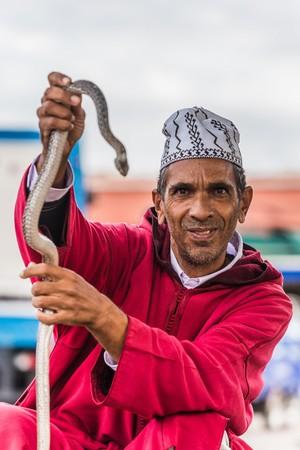 charmer: marrakesh, Morocco - Circa September 2015 - snake charmer on djemaa el fna