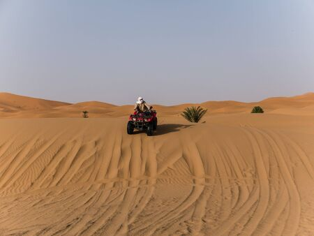 quad: an arabic guy on a quad in the desert