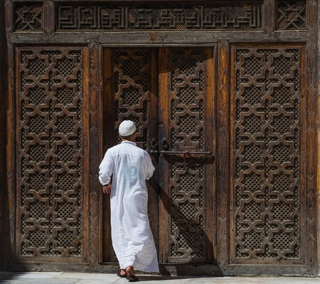 clothed: a traditionally clothed man in fes