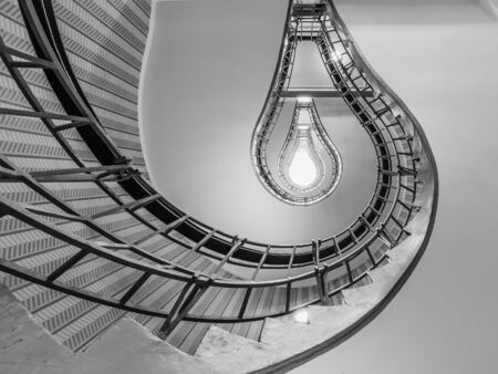 leading light: Abstract shot of a staircase leading towards a light bulb like opening Stock Photo