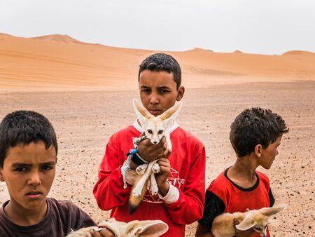 merzouga: merzouga Morocco - Circa September 2015 - young children with desert foxes