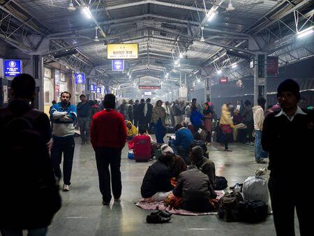 gurgaon: Khajuraho, India - Circa January 2016 - many people at the train station at night