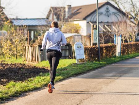 jogger: Heidelberg, germany - december 10, 2015 - Jogger on the field