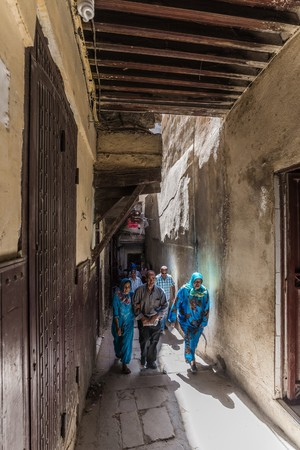 fes: fes, Morocco - Circa September 2015 - local people walking in the narrow streets of fes