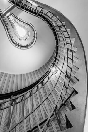 leading light: Abstract shot of a staircase leading towards a light bulb like opening Editorial