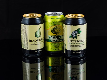 Heidelberg, germany - december 10, 2015 - cans of cider isolated on black