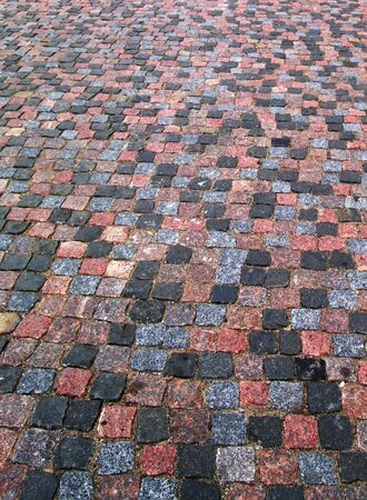 Old cobblestone pavement texture, background vertical photo