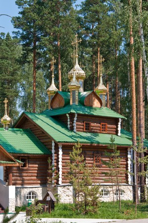 urals: Wooden orthodox church among the pine trees in Russia, Urals
