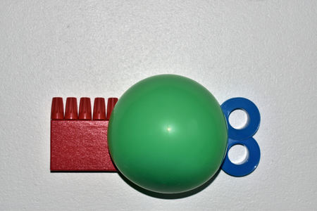 Red Green Blue Objects on White Background,