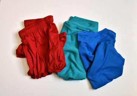 Red Green Blue Clothes on White Background Banco de Imagens