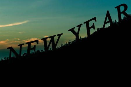 new year silhouette text on mountain background
