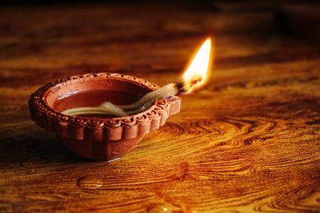 Diwali festival lamp on wooden background Stock Photo
