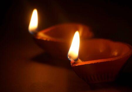 Diwali festival lamp on wooden background Foto de archivo