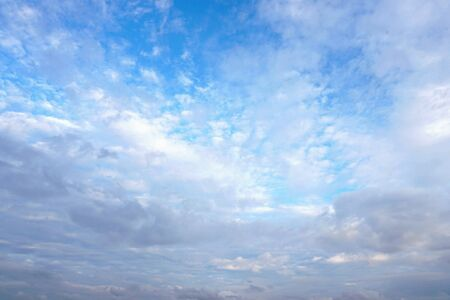 Dark and white clouds on blue sky Stock Photo