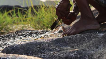 Indian man preparing the fishing net