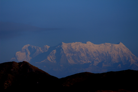 Mt. Chaukhamba, a snow capped Himalayan peak in Uttarakhand, India as seen from Roopkund lake at sunrise.