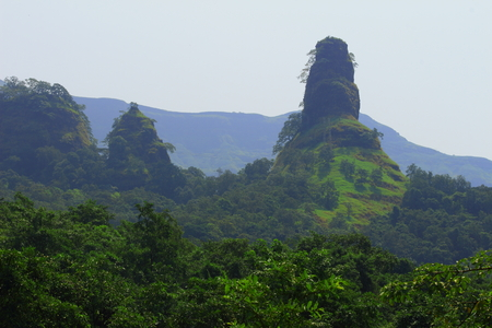 A rock pinnacle in the midst of the forests of the western ghats of Maharashtra, India.
