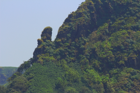 A rock pinnacle attached to a mountain ridge in the western ghats of Maharashtra, India Stock Photo - 118846994