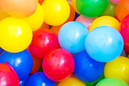 balloon background: Balloons of many colours in a large pile Stock Photo