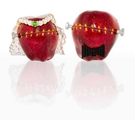 Altered apples in wedding clothing   A versatile concept piece with many uses from Halloween to genetically modified, altered, processed, or pro organic food concepts     Standard-Bild