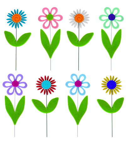 Felt flowers isolated on a white background in a variety of colors  photo