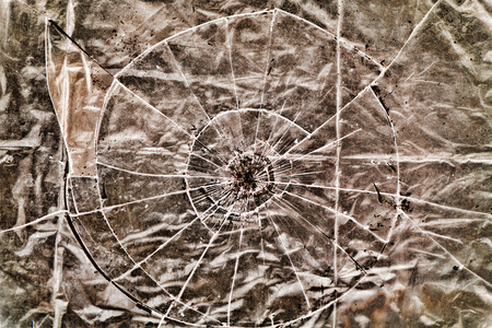 gritty: Broken Glass over a highly textured surface    This image makes a great background or use as a gritty Broken Glass grunge layer to any image