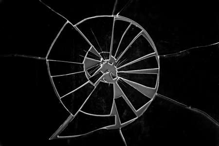 gritty: Broken Glass over a grainy surface    This image makes a great background or use as a gritty Broken Glass grunge layer to any image    Presented in low key Black and White