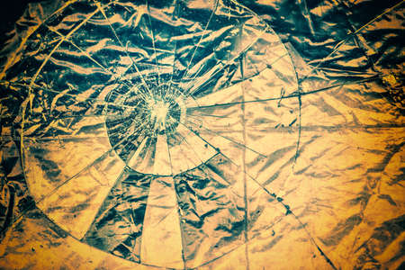 gritty: Broken Glass over a highly textured surface.   This image makes a great background or use as a gritty Broken Glass grunge layer to any image. Toned for a vintage retro look.