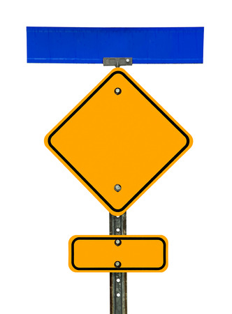 Photograph of a blank diamond shaped yellow caution traffic sign with black border, a rectangular one below, and blue street sign above it.  All text letters have been removed. Isolated on a white background.