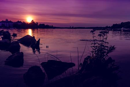 muskoka: Photo of a summer sunset over  Muskoka Bay - Gravenhurst, Ontario, Canada   Horizontal orientation  Stock Photo