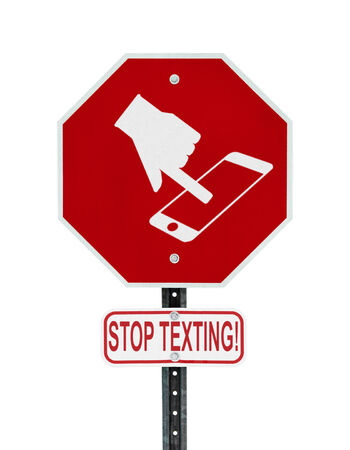 cellphone in hand: A red stop sign with a symbol of a hand texting on handheld smartphone device and the words stop texting written on a sign bellow   Symbol is artist own conceptual design