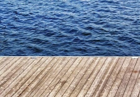 muskoka: A dock on the lake with gentle waves.