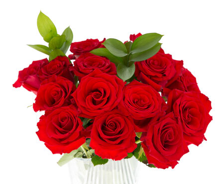 A bouquet of red roses in a glass vase.