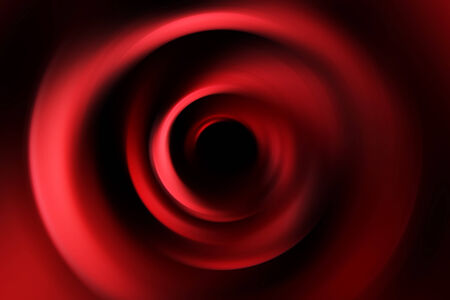 ripple effect: A close up view of dark red circle swirls.