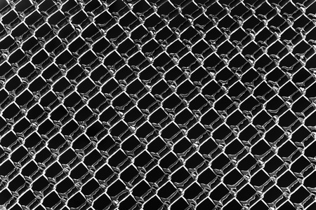 An abstract background image of a color inverted chain link fence processed in black and white.  photo