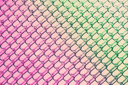 An abstract background image of a chain link fence.   photo
