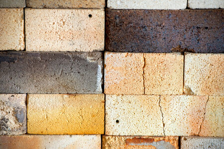 firebox: A close up background image of the texture of worn, cracked fire bricks in a kiln used to fire pottery wares.