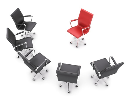 Black chairs around a single red