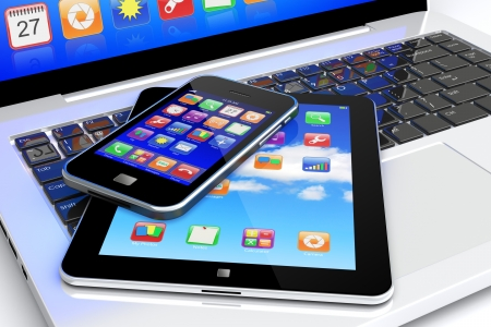 Tablet PC and mobile smartphone with colorful apps on a screen lying on laptop keyboard  Technology 3d concept