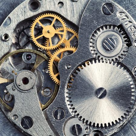 clock gears: Metal gears of old clock mechanism Stock Photo