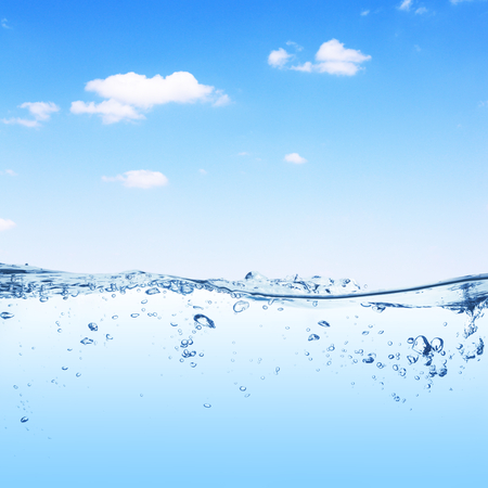 under water: Clear water surface under the blue sky Stock Photo