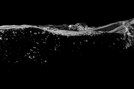 Clear water surface on a black with ripple and bubbles Stock fotó