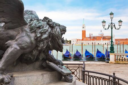 maggiore: Venice. Italy. Lion of monument to Vittorio Emanuele ii. In the background is the island  of San Giorgio Maggiore  and the Church of San Giorgio Maggiore