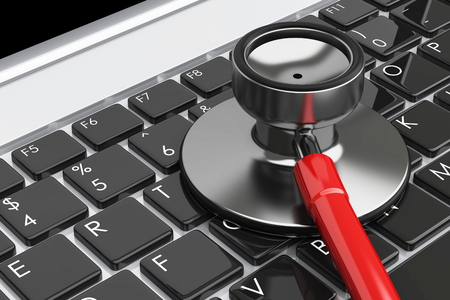 computer key: Stethoscope lying on laptop keyboard. A computer repairing and antivirus concept