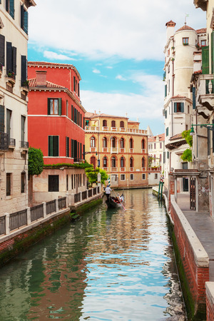Italy. The cityscape and architecture of Venice. City canal and gondola floating on it