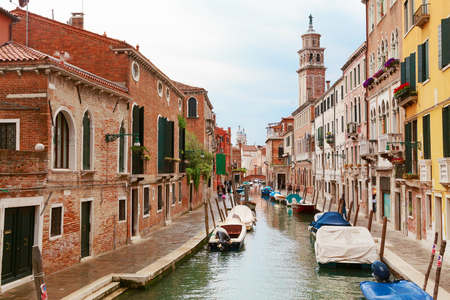 Italy. The cityscape and architecture of Venice. Urban canal and boats on it Stock Photo