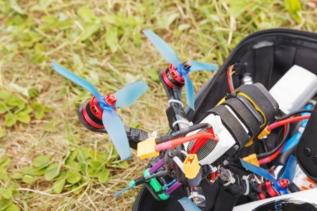 A fpv high-speed racing drone copter lying on the grass Reklamní fotografie